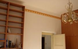 Malování pokoje s okrasnou linkou
